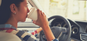 woman-driving-with-coffee